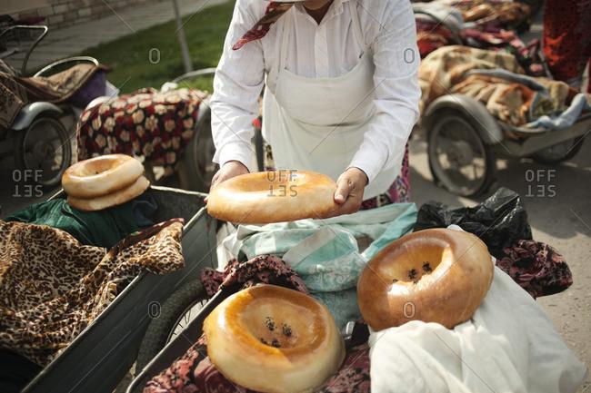 Seller of traditional bread of Samarkand, Uzbekistan