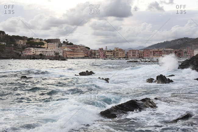 Crashing ocean waves during a storm in the small harbor of Sestri Levante, Italy