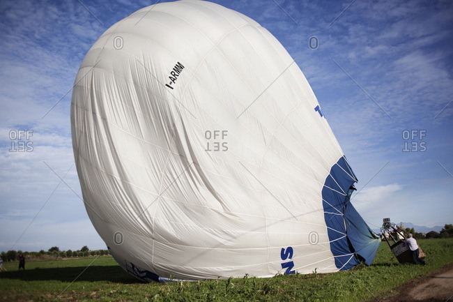 Deflating hot air balloon on the ground