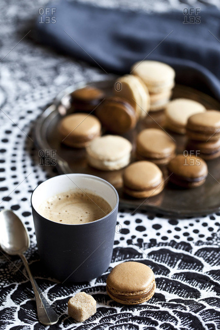 Coffee and tray of macaroons