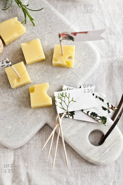Pieces of cheese with decorative toothpicks