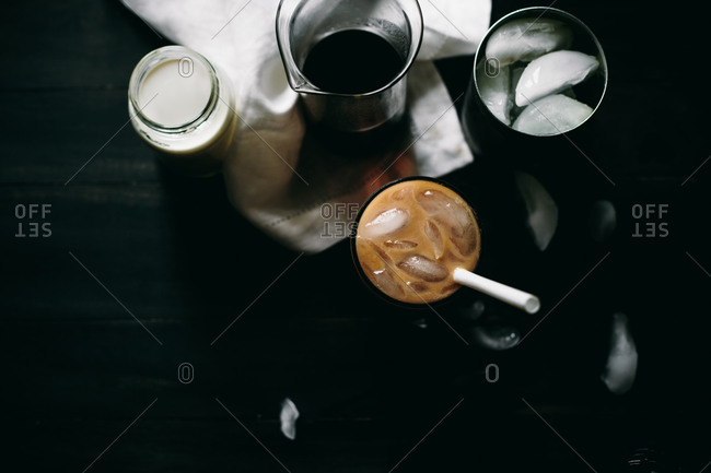Glass of iced coffee and ingredients