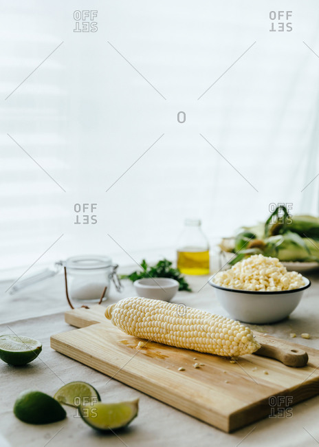 Kernels of corn and limes for salad