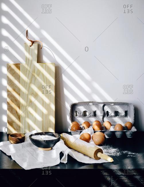 Baking ingredients and utensils in sunlight