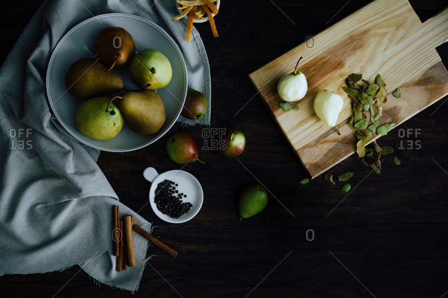 Raw pears peeled by spices