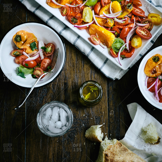 Roasted pepper and tomato salad being served