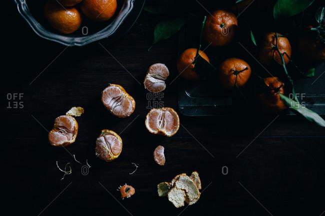 Satsuma citruses whole and peeled