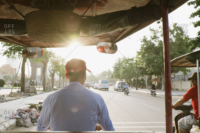 Cambodian taxi drivers in traffic