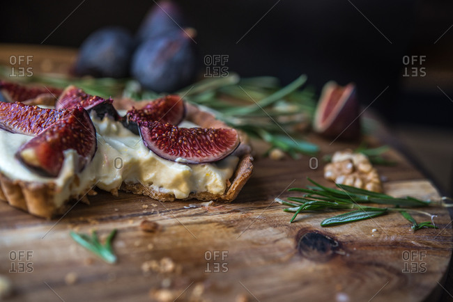 Fig topped custard tart with piece removed