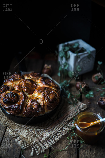 Cinnamon rolls in pan with caramel glaze