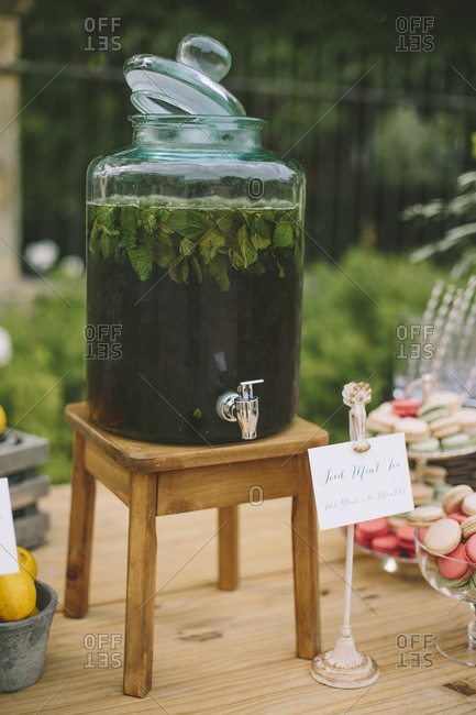 Refreshment dispenser and macaroons on wedding table