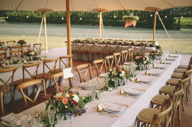 Wedding reception tables under tent