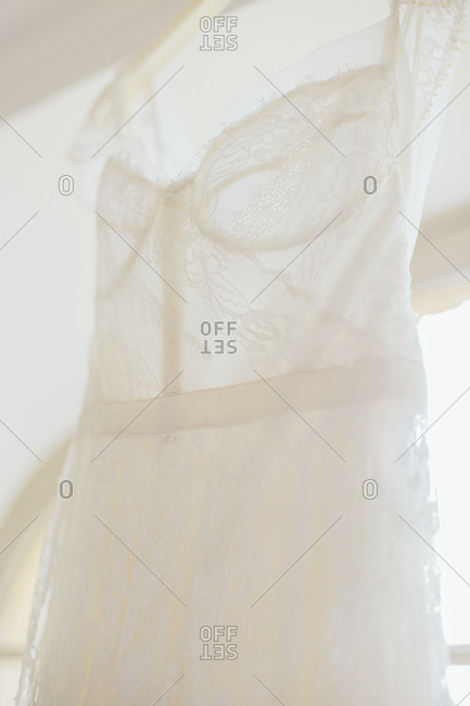 Dress slip hanging in window
