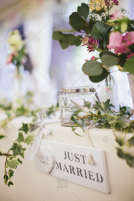 Just married sign hanging on bridal table