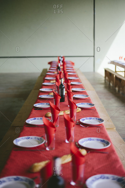 Long table set for communal supper