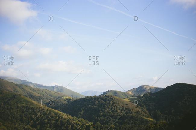 Forests dotting rural rolling hills