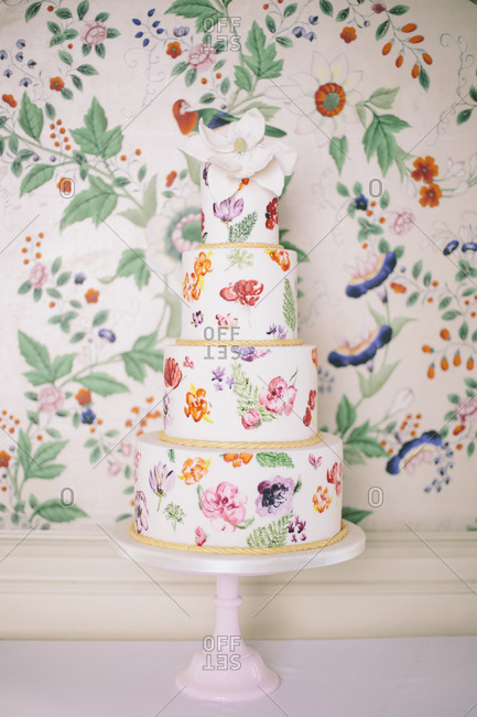 Tiered wedding cake with floral paintings