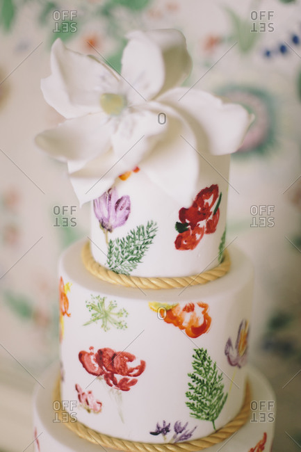 Tiered wedding cake with flower paintings