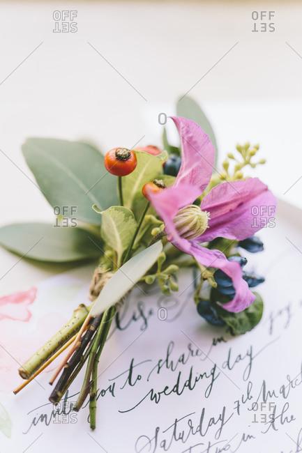 Floral arrangement on wedding invitation