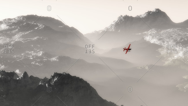 Misty mountain landscape at dawn with red airplane flying over