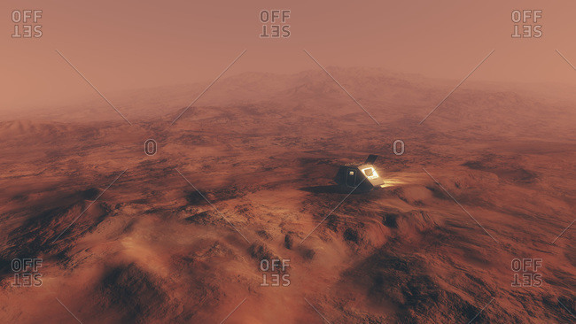 Elevated view of space capsule on surface of red planet