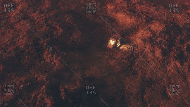 Aerial of space capsule on surface of red planet