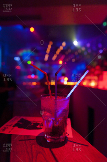 Large mixed drink inside a nightclub