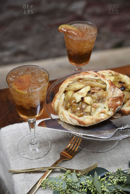Apple tarts next to two cocktails