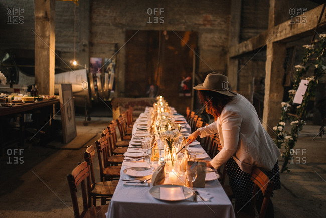 Preparing for a large dinner party in a loft