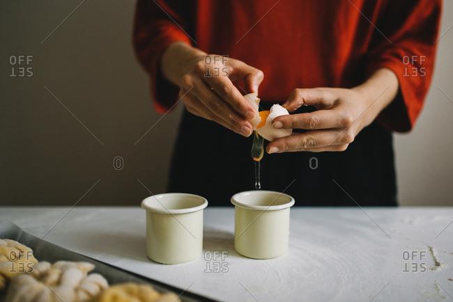 Woman cracking an egg into a bowl