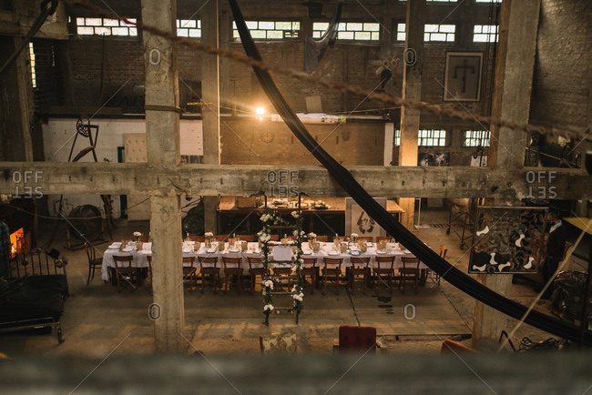 Industrial loft space set up for a dinner party