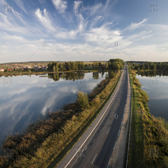 Men fishing off the side of a road to Kaisiadorys, Lithuania