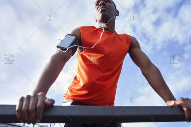 Man wearing armband for smartphone while working out