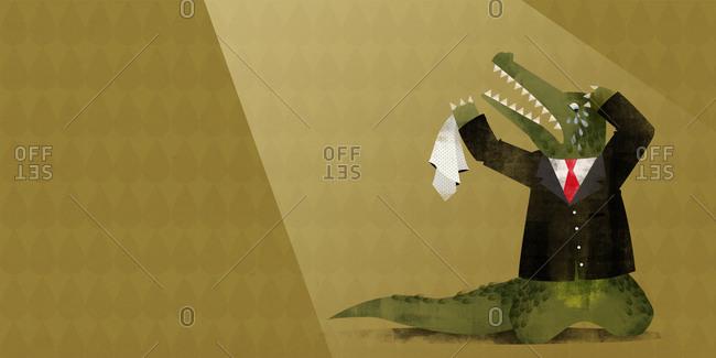 Crocodile crying under a spotlight