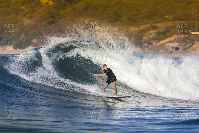 Blonde man surfing