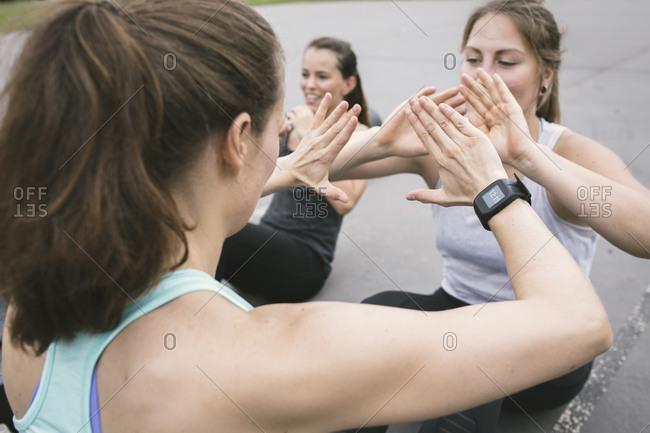 Women having an outdoor boot camp workout