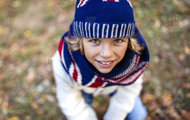 Portrait of blond boy wearing knit wear in autumn