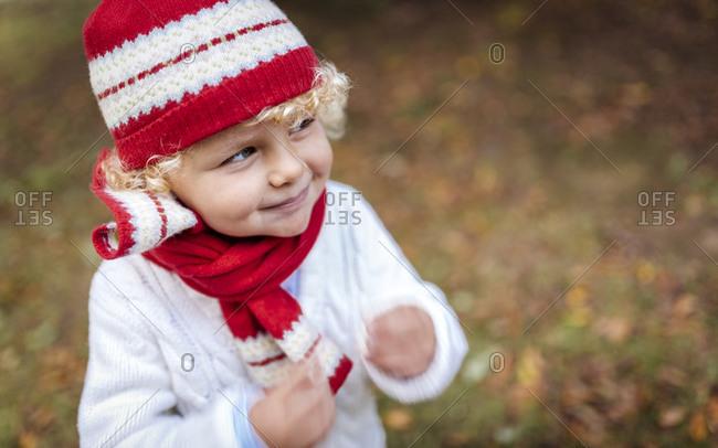 Portrait of blond little boy wearing knit wear in autumn