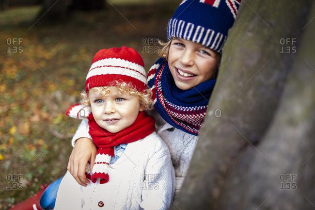Portrait of two blond boys wearing knit wear in autumn