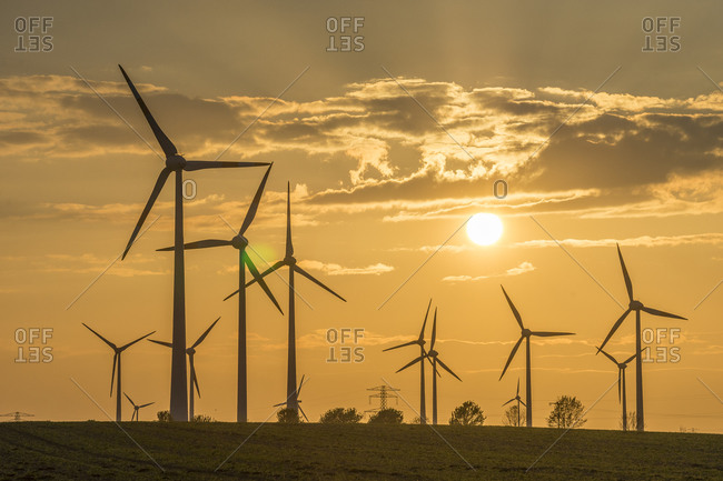 Wolfsburg, Germany - May 7, 2015: Wind farm at sunset