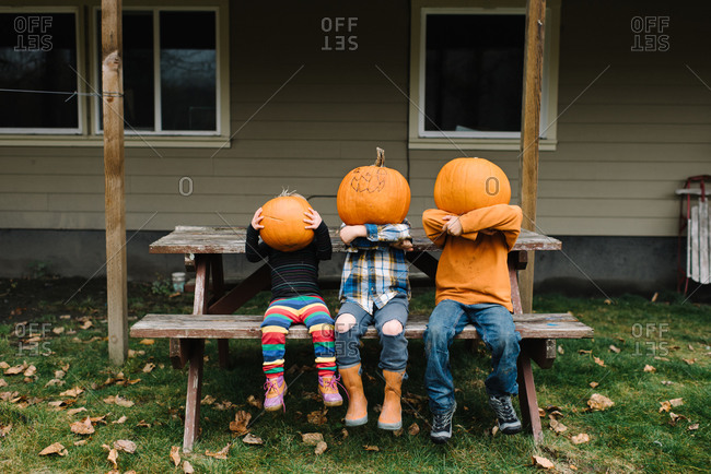Children posing with their pumpkins