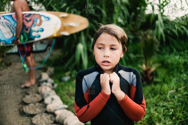 Little boy in a wetsuit
