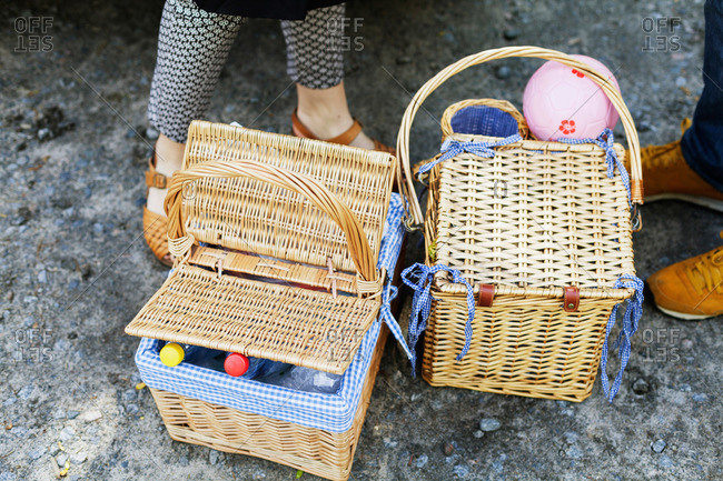 Man and woman's feet with picnic baskets