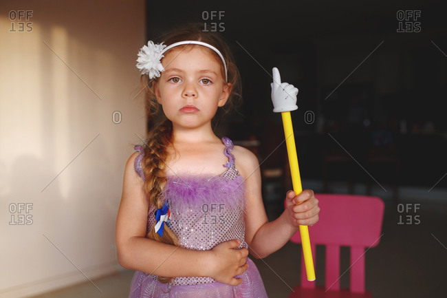 Portrait of a girl playing dress up