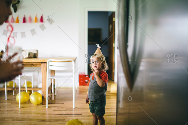 Toddler boy wearing a party hat