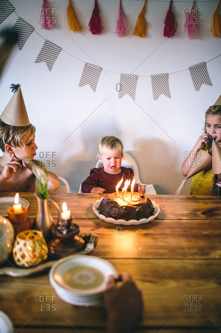 Toddler girl upset at birthday celebration