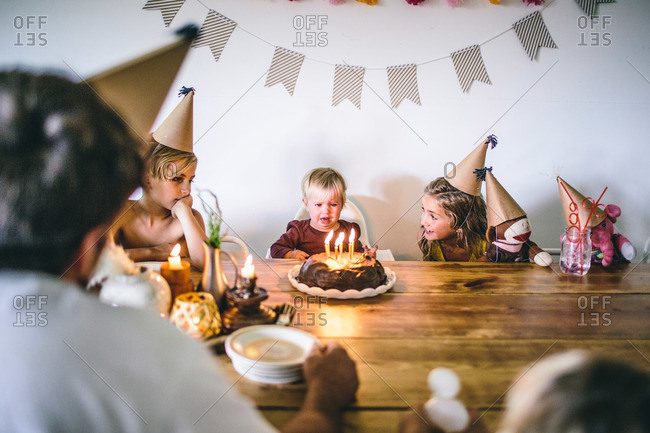 Toddler girl upset at birthday party
