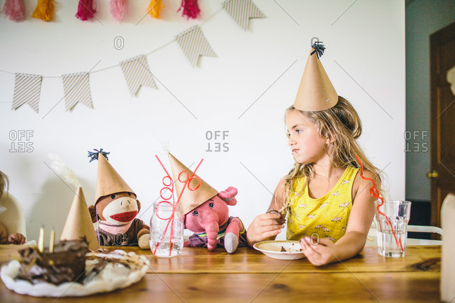 Girl and stuffed animals at birthday celebration