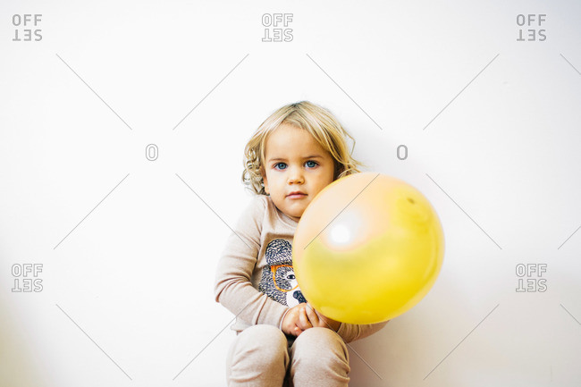 Toddler boy holding a balloon