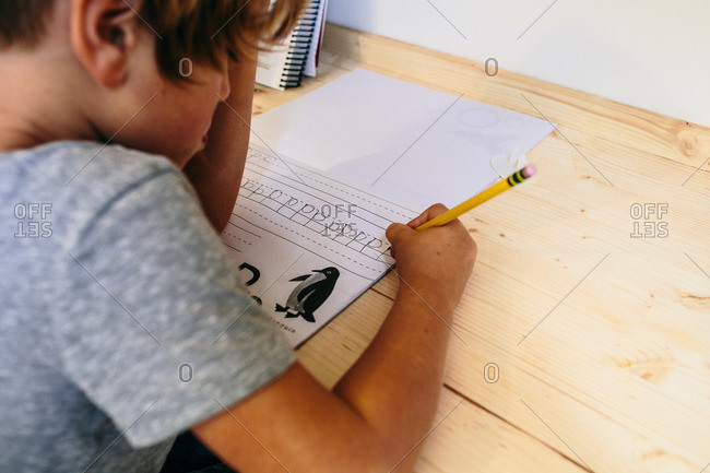 Boy practicing handwriting homework
